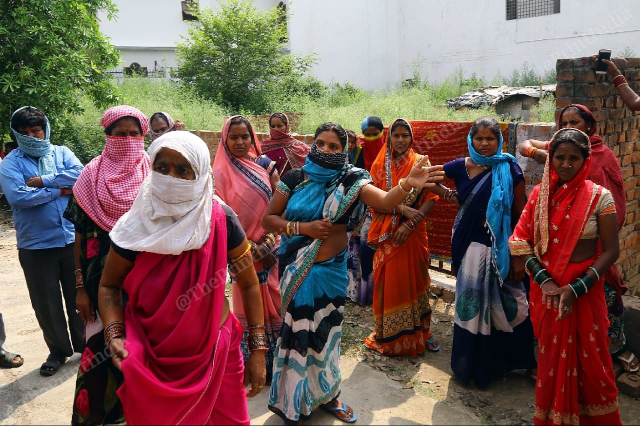 Women at Viraj Khand in Lucknow wait for free food on 28 April | Photo: Suraj Singh Bisht | ThePrint