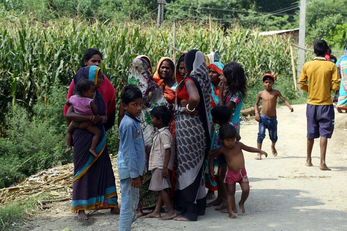 Relatives of the three women at the village | Suraj Singh Bisht | ThePrint