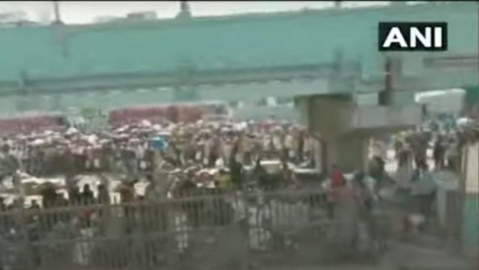 Screenshot from an ANI video shows the crowd that gathered at Bandra Terminus Tuesday morning | ANI