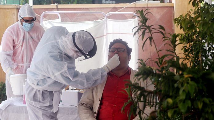 Representational image of a doctor conducting a Covid-19 test in New Delhi | Photo: ANI