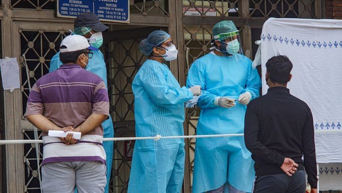Medics attend to patients at a government hospital, during the ongoing COVID-19 nationwide lockdown in New Delhi | PTI
