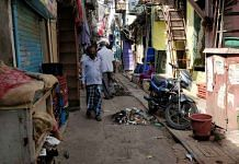 Muck extracted from drains lines a congested Dharavi lane | Swagata Yadavar | ThePrint