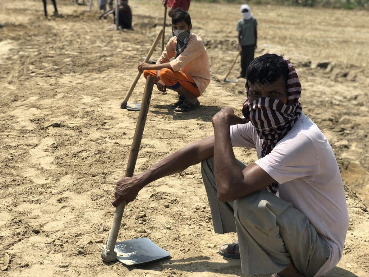 After reaching home in late March, the workers had quarantined themselves for 14 days and then started working on farmlands | Photo: Jyoti Yadav | ThePrint
