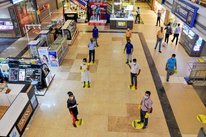 Representational image. Shoppers maintain social distance while standing in a queue at Lake Mall, Kolkata after it reopened Monday. | PTI