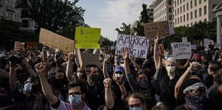 Demonstrators gather at Lafayette Park for protest against police brutality and the death of George Floyd | Photographer: Drew Angerer | Getty Images North America via Bloomberg