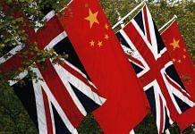 Chinese and British flags fly on Pall Mall on November 7, 2005 in London, England. | Bloomberg