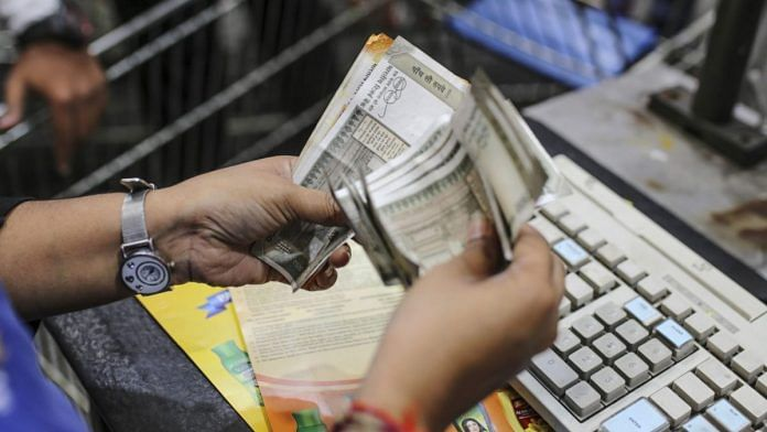 An employee counts Indian rupee banknotes at a Walmart Inc. Best Price Modern Wholesale store in Hyderabad, India, on 16 March 2019 (Representational Image) | Photo: Dhiraj Singh | Bloomberg