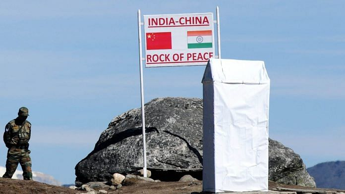Indian Army personnel keep vigilance at Bumla pass at the India-China border in Arunachal Pradesh | Photographer: Biju Boro via Getty Images | Bloomberg