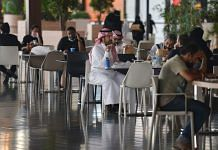 People sit at a cafe in a mall in the Saudi capital Riyadh on June 4, 2020, after it reopened following the easing of some restrictions put in place by the authorities | Photographer: Fayez Nureldine | AFP/Getty Images via Bloomberg