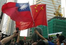 People holds up flags of China and Taiwan at Hong Kong. China views Taiwan as an inalienable part of its territory that must be brought back under Beijing's control | Twitter