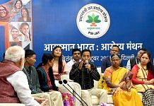 Representational image of PM Narendra Modi (far left) interacting with beneficiaries of Ayushman Bharat PM-JAY | Photo: ANI