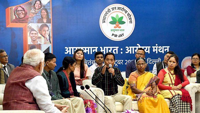 Representational image of PM Narendra Modi (far left) interacting with beneficiaries of Ayushman Bharat PM-JAY   Photo: ANI