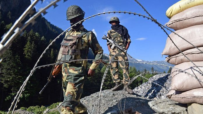 Border Security Force soldiers stand guard at a checkpoint along a highway leading to Ladakh, at Gagangeer in Kashmir's Ganderbal district on 17 June 2020