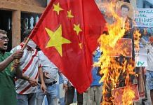 A Chinese flag and an effigy of President Xi Jinping are burnt during a protest against the Galwan Valley clash, in Kolkata | Representational image | ANI