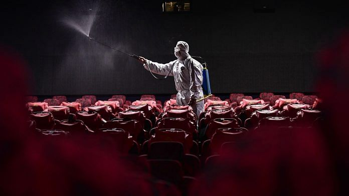 A staff member spraying disinfectant at a cinema in Shenyang in China's northeastern Liaoning province