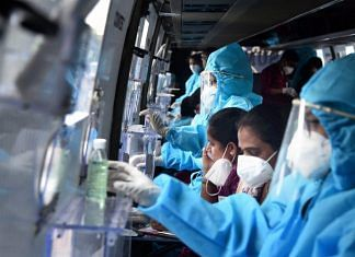 Healthcare workers prepare themselves to collect swab samples (Representative image)   PTI