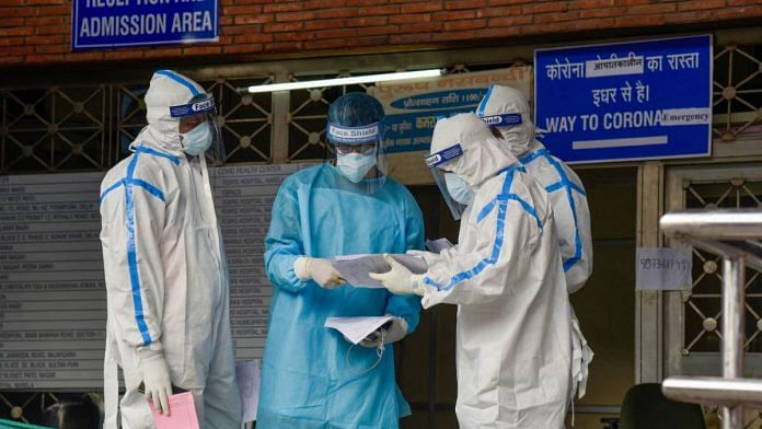 Health workers in protective suits at LNJP Hospital in New Delhi on 15 June 2020 | Manvender Vashist | PTI
