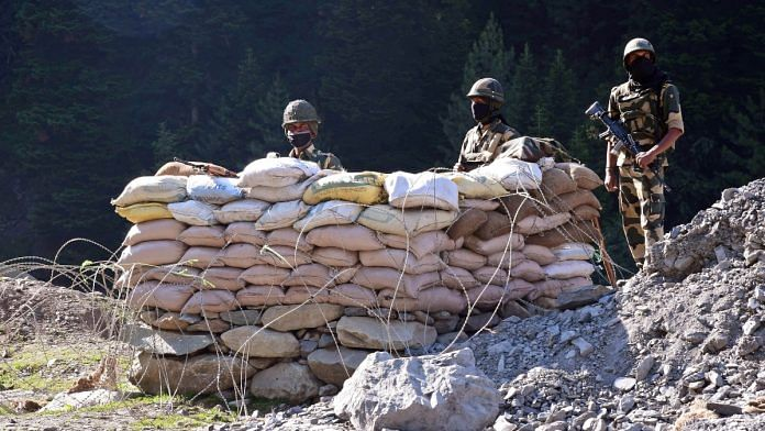 BSF soldiers stand guard at a checkpoint along a highway leading to Ladakh in Kashmir's Ganderbal district on 17 June 2020