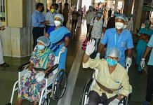 Medics and hospital staff applaud as patients who recovered from Covid-19 prepare to leave Krishna Hospital in Karad, Maharashtra, on 10 June 2020 | PTI