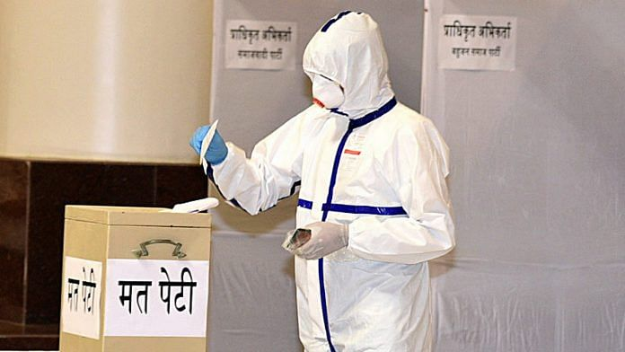 Congress MLA Kunal Chaudhary, who had tested positive for Covid-19, cast his vote in Friday's Rajya Sabha elections in a full PPE kit | Photo: ANI