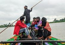 Residents of a remote area of Dhubri, a district in Assam, travel on boats to reach their houses. The flooded areas through which the boats traverse are paddy fields   Yimkumla Longkumer   ThePrint
