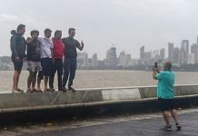 A group of people pose for pictures at Marine drive during Cyclone Nisarga, in Mumbai on 3 June 2020 | Shashank Parade | PTI