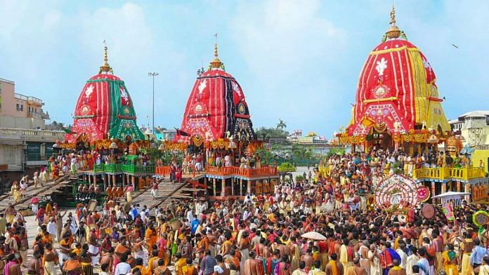Priests and devotees take part in the 'pahandi' rituals of Lord Jagannath Rath Yatra in Puri on 23 June 2020 | PTI