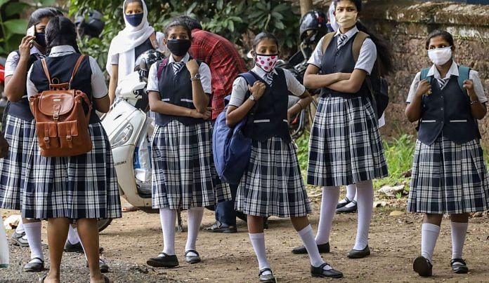 Kozhikode: Students outside a school after giving a Board examination, May 27, 2020 | PTI