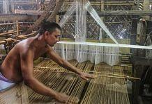 Weaver Lakhyadhar Deka operates his handloom in Sualkuchi village, Assam's textile hub | Photo: Angana Chakrabarti | ThePrint