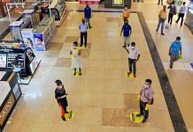 File photo | Shoppers maintain social distance while standing in a queue at Lake Mall, Kolkata | PTI