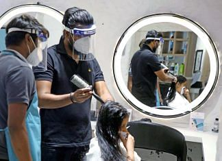Salon workers don face shields to serve a customer in the 'Unlock 1' phase of the Covid-19 lockdown   Photo: ANI