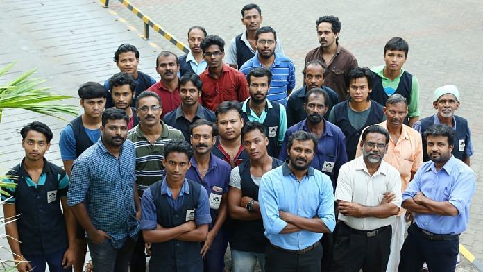 Mezhukkattil Mill executive director Ubais Ali (third from right in thr front row) with his employees | By special arrangement