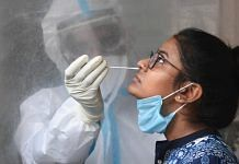 A medic collects a sample of a woman for COVID-19 testing, during the ongoing nationwide lockdown, in New Delhi   Representational image   PTI