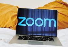 The logo for the Zoom Video Communications Inc. application seen on a laptop