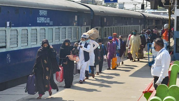Migrants arrive to board a train to reach their native places in Dhanbad (Jharkhand) and Bihar at a railway station, during the ongoing COVID-19 lockdown.   PTI