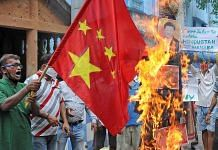A Chinese flag and an effigy of President Xi Jinping are burnt during a protest against the Galwan Valley clash, in Kolkata Thursday | Representational image | ANI