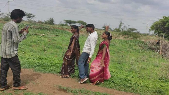 Dinesh Pawar of Jamde, Maharashtra, dances to a 1990s Bollywood song with his two wives while a neighbour films them | By special arrangement