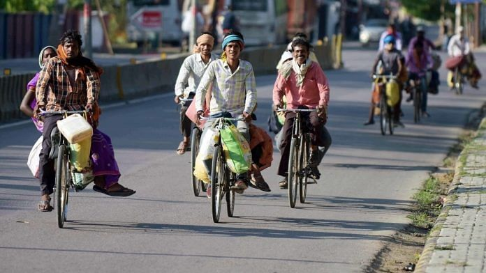 A file photo of migrant workers cycling to Chhattisgarh from Prayagraj during the lockdown. | Photo: ANI