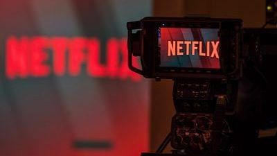 A television camera focuses on the Netflix logo