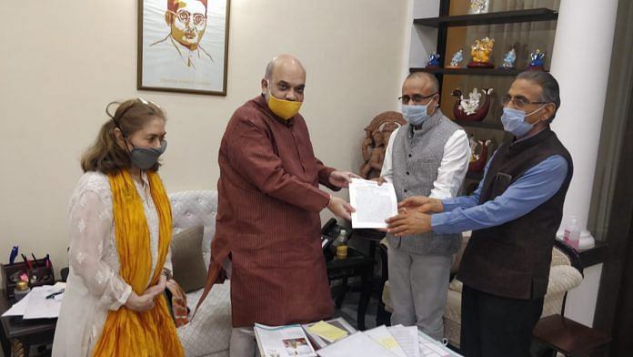 The Call of Justice team presenting its fact-finding report to Amit Shah | By special arrangement.