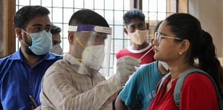 A health worker collects a sample of a patient in Gurugram Saturday, July 4, 2020. | PTI
