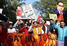 ABVP activists hold up placards and cut-outs of Swami Vivekananda and Dr B.R. Ambedkar at a demonstration | File photo: ANI