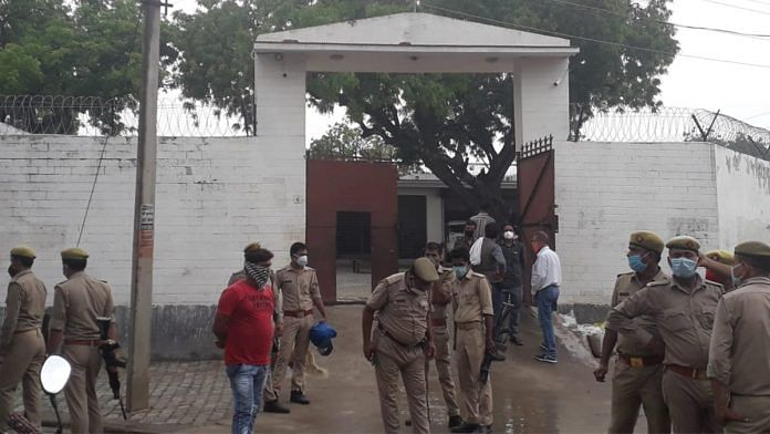 Police personnel at the residence of criminal Vikas Dubey, after an encounter in Bikaru village where 8 police personnel lost their lives | PTI