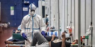 A health worker wearing PPE suit attends COVID-19 patients at quarantine Center, CWG Village, in New Delhi on 15 July 2020 (representational image)   ANI