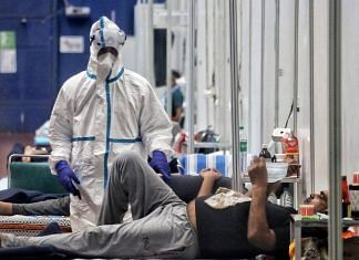 A health worker wearing PPE suit attends COVID-19 patients at quarantine Center, CWG Village, in New Delhi on 15 July 2020 (representational image) | ANI