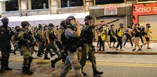 Police officers attempt to disperse crowds during a protest in Hong Kong