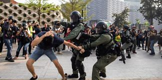 File photo of riot police attempting to apprehend and arrest a demonstrator during a protest in the Tsim Sha Tsui district of Hong Kong