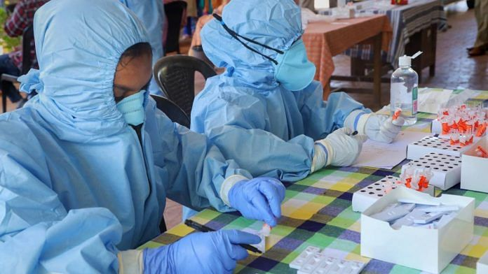 Health workers prepare to collect swab samples for COVID-19 tests, at an office in Kozhikode on 21 July 2020 | PTI