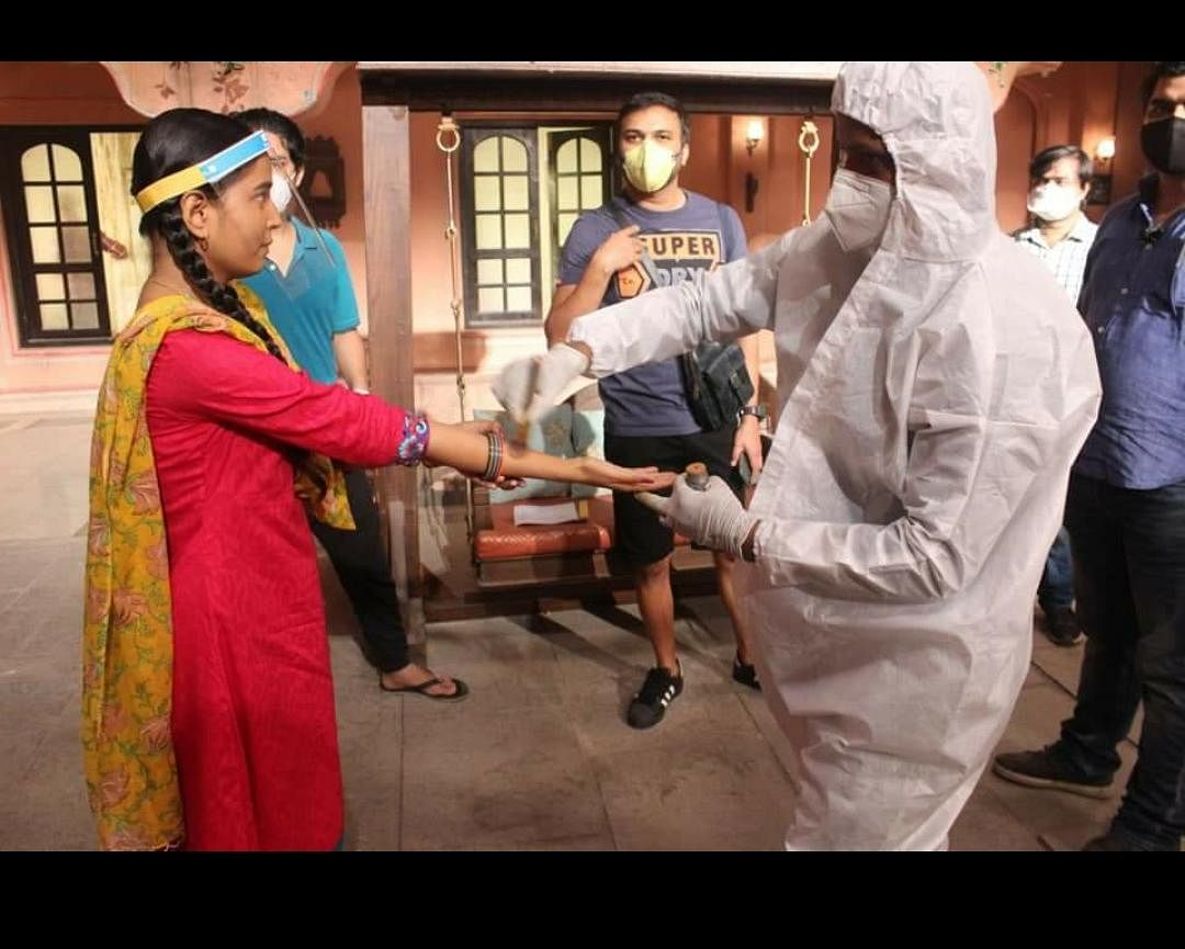 An actor wears a face guard while in close contact with a crew member on the sets of 'Gudiya Humari Sabhi Pe Bhari' | Photo by special arrangement
