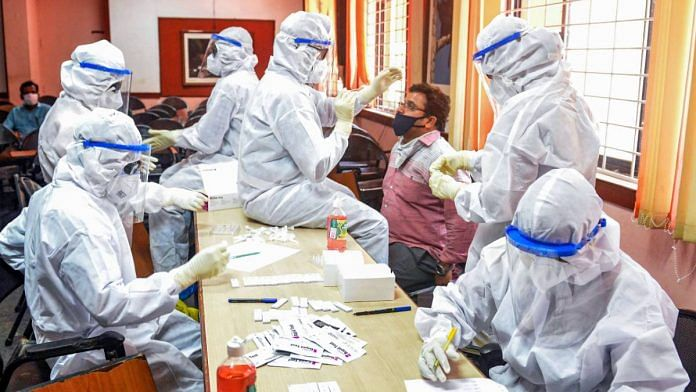 Health workers in PPE kits collect swab samples at a Covid-19 test centre in Palakkad, on 27 July 2020 | PTI